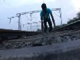 Indian Boy Lies On Tracks Under Train- Please Do NOT Try This Yourself