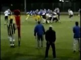 Cheerleader Tackles Football Player