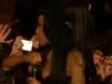 Flashback: Amy Winehouse Punches Fan At Glastonbury 08