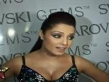 Busty Celina Jaitley Shows Her Huge Bosoms