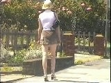 Girl Walking Along Street In Mini Skirt