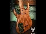Hufschmid 8 String Baritone Salvaged Old Growth Maple Top