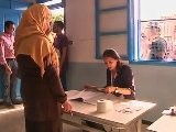 Tunisians Pack Polling Stations