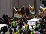 Around The World: Thousands Rally In South Africa
